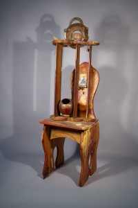 sitting figure on painted chair, recycled sculpture