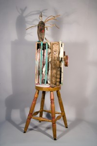 figure on stool with screaming head, recycled mix-media