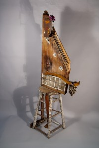 figure on stool out of musical instrument, mix-media sculpture